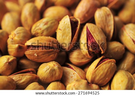 Fresh salted pistachios abstract background - stock photo