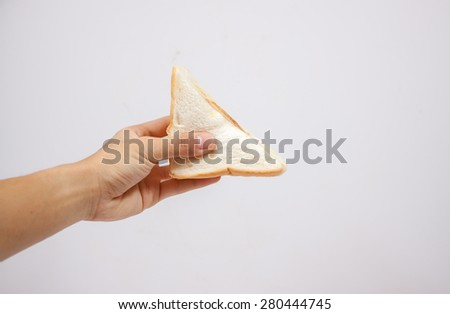 Fresh sandwich in hand. Isolated on a white background. - stock photo