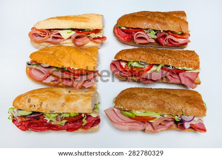 Fresh sandwich isolated on white. Assorted delicious baguette sandwiches. - stock photo