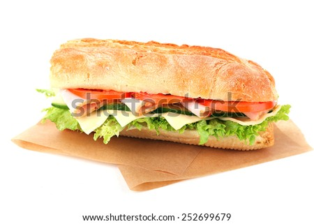 Fresh sandwich on parchment isolated on white