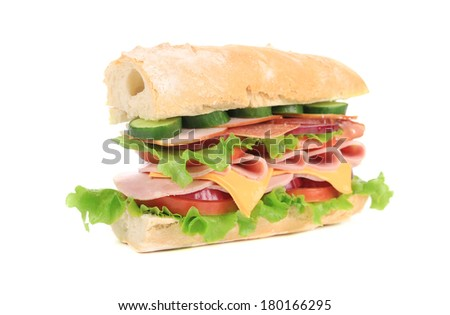 Fresh sandwich with ham and vegetables. Isolated on a white background.