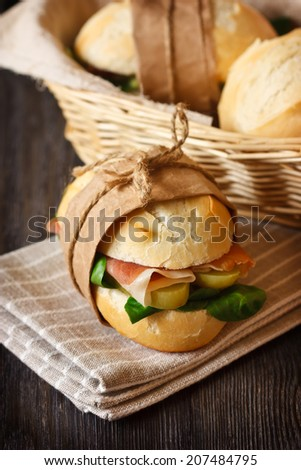 Fresh sandwich with ham and vegetables. Rustic style. - stock photo