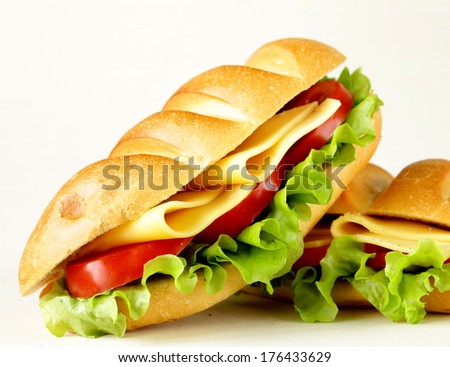 Fresh sandwich with vegetables, green salad and cheese - stock photo