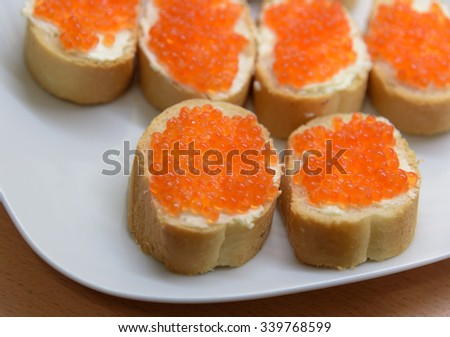 Fresh sandwiches with butter and red caviar