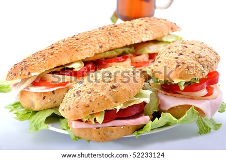 Fresh sandwiches with ham and cheese and tea - stock photo