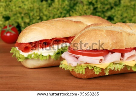 Fresh sandwiches with ham and smoked salmon, selective focus