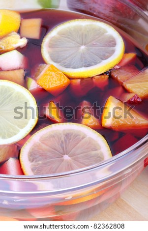 Fresh sangria in glass bowl, closeup - stock photo