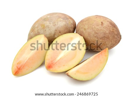 Fresh sapodilla plum with cut isolated on white with clipping path - stock photo