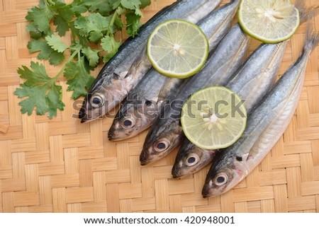 fresh sardine fish in the bamboo basket - stock photo