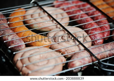 Fresh sausages on grill