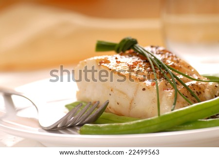 Fresh sauteed cod fillet with green beans and chives - stock photo