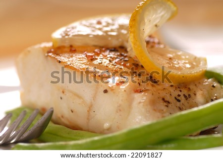 Fresh sauteed cod fillet with green beans and lemon - stock photo