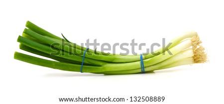Fresh scallions isolated on a white background - stock photo