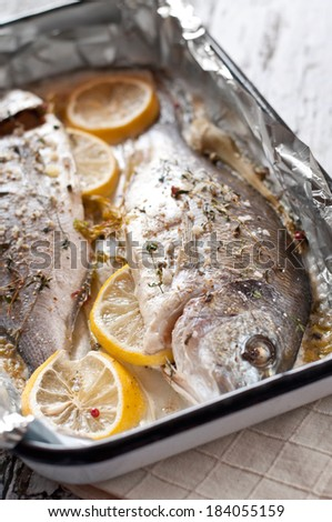 Fresh sea bream with lemon and thyme - stock photo