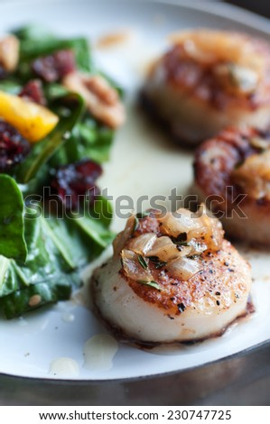 Fresh sea scallops pan seared with white wine sauce and salad - stock photo