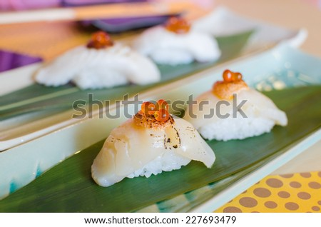 Fresh sea scallops sushi with salmon roe - stock photo