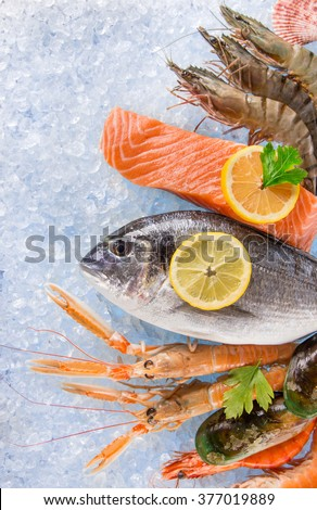 Fresh seafood on crushed ice, close-up. - stock photo