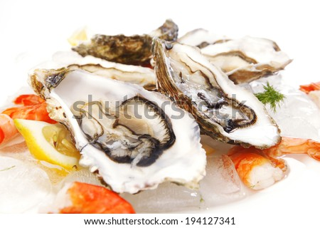 Fresh seafood on ice macro - stock photo