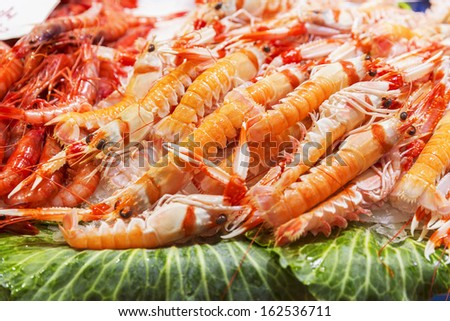 Fresh seafood on ice. Shrimp, crayfish, clams and lobster/Seafood market - stock photo