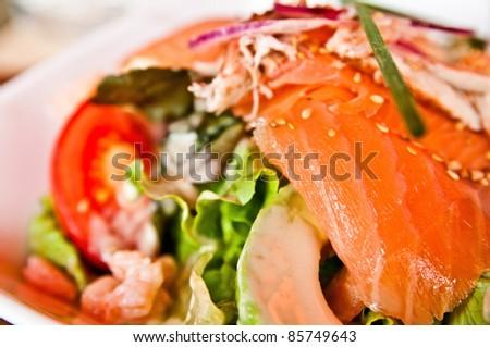 Fresh seafood salad with smoked salmon - stock photo