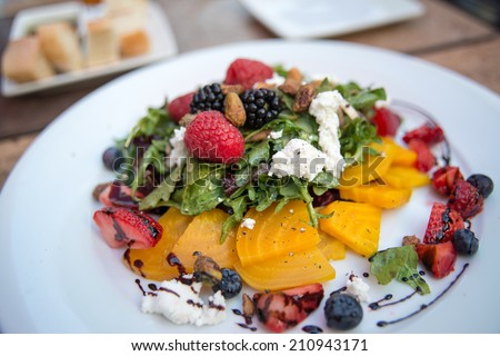 Fresh Seasonal Berries and Arugula Salad Served with Fresh Goat Cheese and Golden Beets