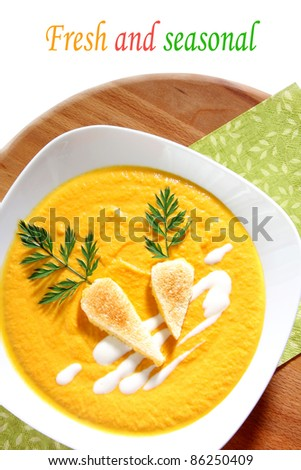 Fresh seasonal carrot soup - stock photo