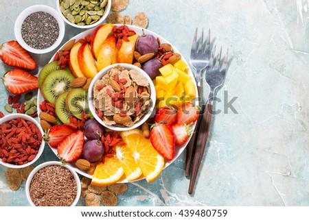 fresh seasonal fruits and superfoods on rustic background, top view, horizontal - stock photo