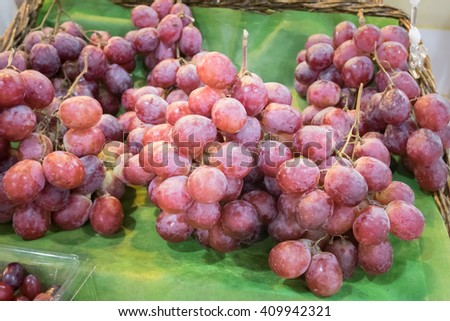 Fresh seedless red grape for sale in market kiosk