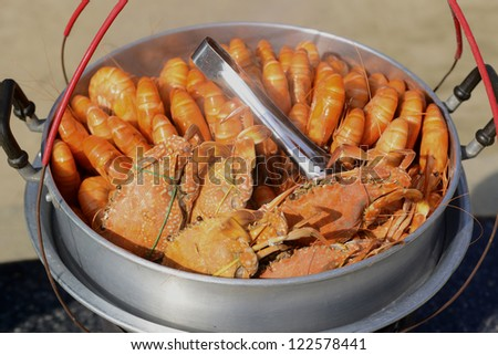 Fresh shrimp and crab steaming in pot for sale on street in Thailand. - stock photo
