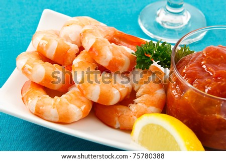 Fresh shrimp are a delicious gourmet appetizer and a dangerous food allergen. - stock photo