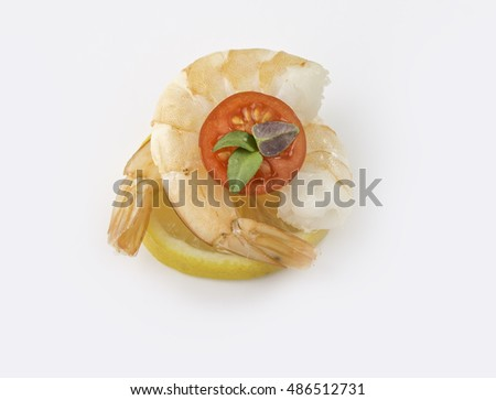 fresh shrimps  on a lemon with sweet tomato and thyme