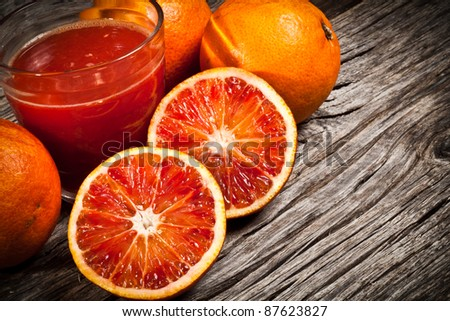 fresh Sicilian orange juice tarot on wood - stock photo