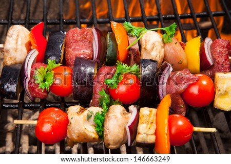 Fresh skewer on grill - stock photo
