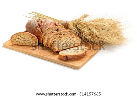 fresh sliced bread  and wheat on wooden board isolated on white