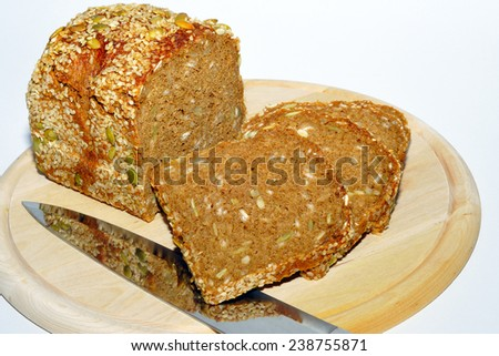 Fresh sliced bread with a knife. - stock photo