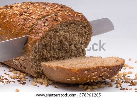 Fresh sliced  bread with seeds on white background