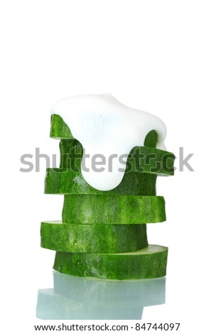 fresh sliced ??cucumber and sour cream isolated on white