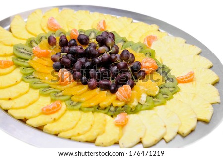 Fresh sliced fruit on the tray isolated  - stock photo