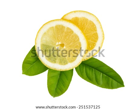 Fresh sliced lemon and leaf isolated on white. - stock photo