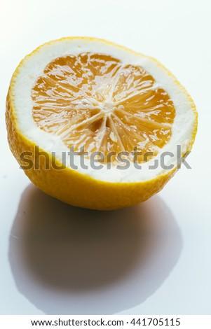 fresh sliced lemon halves on white background. - stock photo