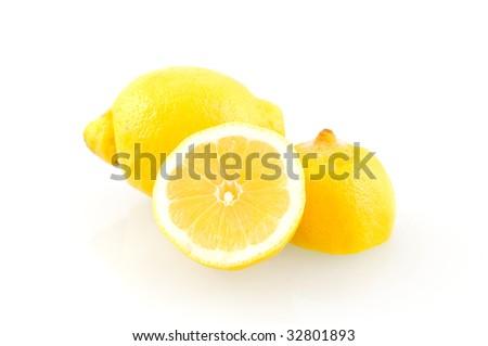 Fresh sliced lemon on white background - stock photo
