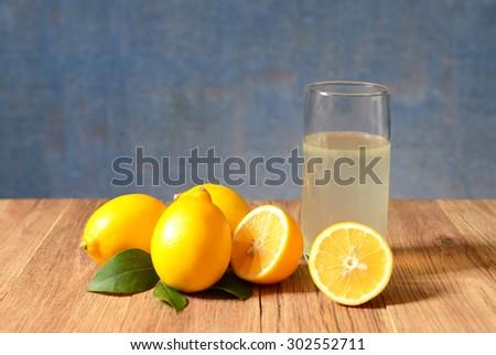 Fresh sliced lemons and leaves  - stock photo