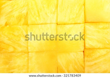 Fresh sliced pineapple cubes close up - stock photo