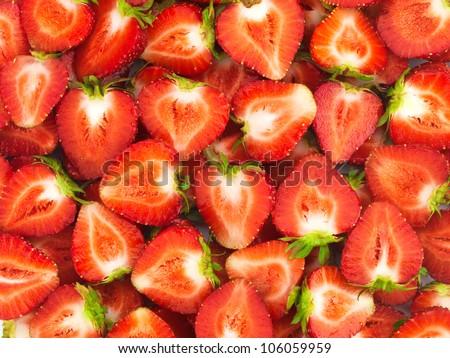 Fresh sliced strawberries summer background - stock photo