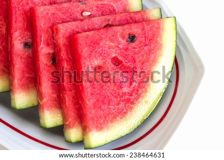 Fresh slices of ripe  sweet watermelon on white plate. - stock photo
