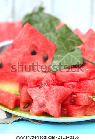 Fresh slices of watermelon on table, on wooden background - stock photo