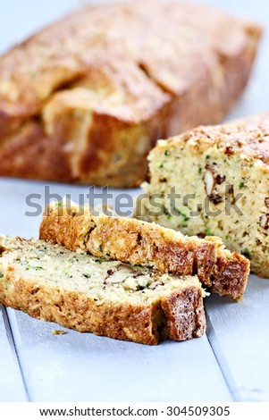 Fresh slices of zucchini bread with shallow depth of field. - stock photo