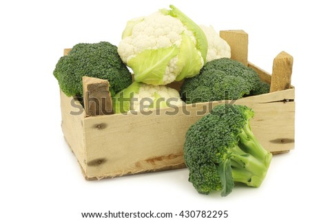 fresh small cauliflower and broccoli in a wooden crate on a white background - stock photo