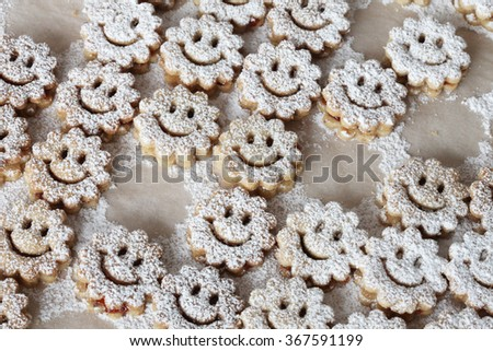Fresh smiley cookies and biscuits  - stock photo