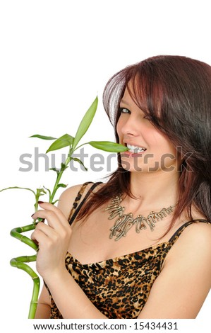 fresh smiling young girl bites a bamboo, isolated on white
